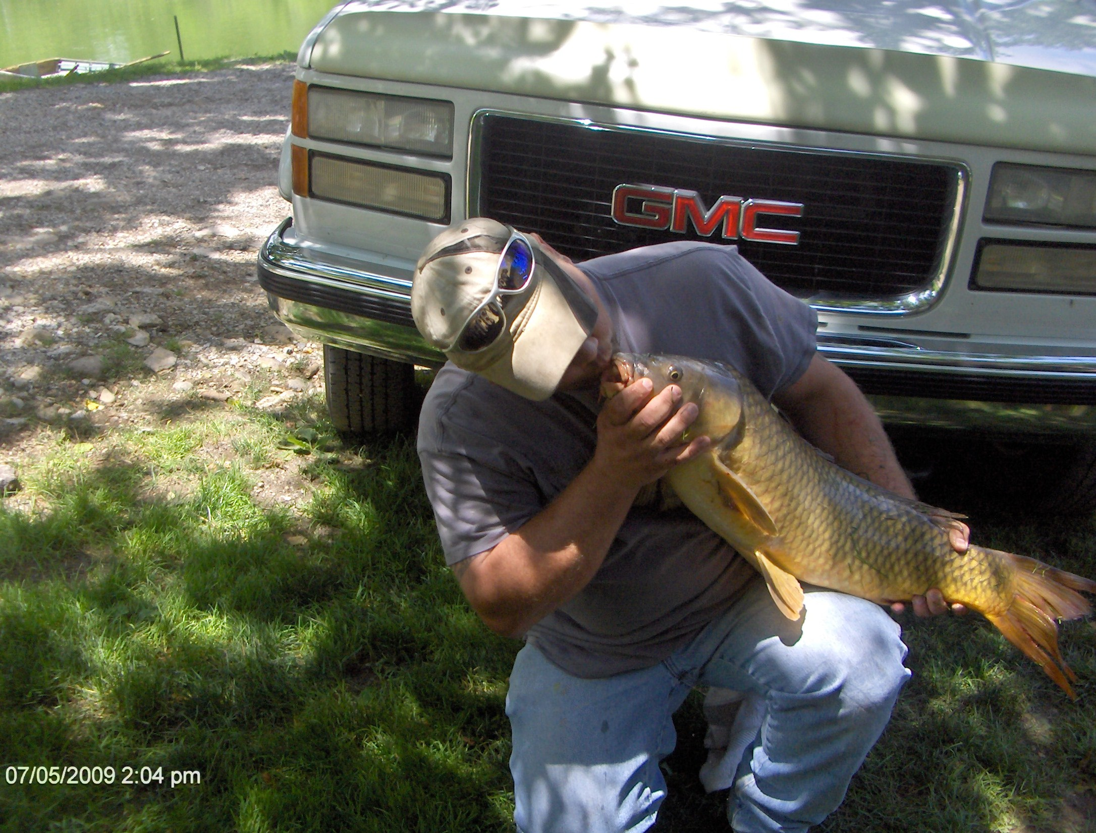 Steve showing the love to that jug busting 16 lb. carp! LOL!